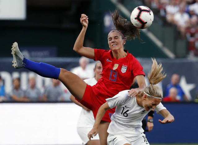 FILE - In this May 16, 2019, file photo, United States' Alex Morgan (13) and New Zealand's Katie Duncan (16) vie for the ball during the first half of an international friendly soccer match in St. Louis. The Women's World Cup kicks off Friday, June 7, 2019, in Paris. Morgan was named the U.S. national team's Player of the Year after she closed out 2018 with 18 goals in 19 games. She had seven goals during the CONCACAF World Cup qualifying tournament alone. (AP Photo/Jeff Roberson, File)