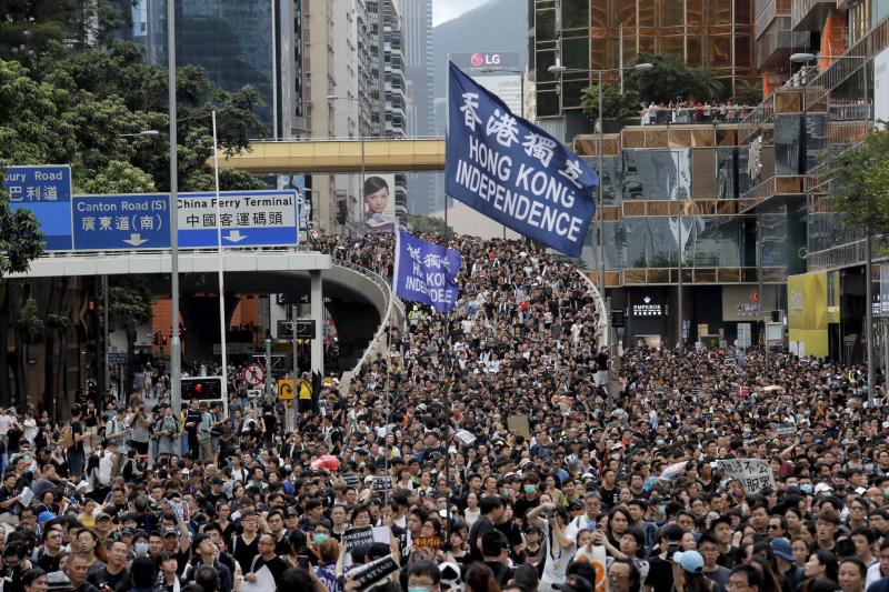 Protesters march with a flag calling for Hong Kong independence in Hong Kong on 7 July, 2019. (PHOTO: AP)