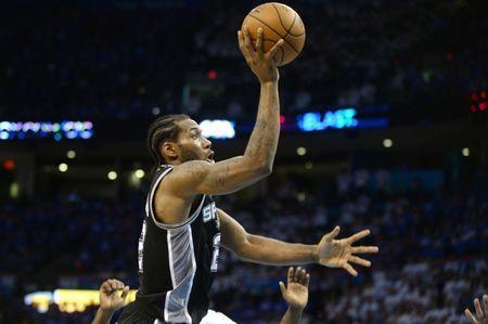FILE PHOTO: May 6, 2016; Oklahoma City, OK, USA; San Antonio Spurs forward Kawhi Leonard (2) shoots the ball against the Oklahoma City Thunder during the fourth quarter in game three of the second round of the NBA Playoffs at Chesapeake Energy Arena. Mandatory Credit: Mark D. Smith-USA TODAY Sports / Reuters Picture Supplied by Action Images (TAGS: Sport Basketball NBA) *** Local Caption *** 2016-05-07T044733Z_810785710_NOCID_RTRMADP_3_NBA-PLAYOFFS-SAN-ANTONIO-SPURS-AT-OKLAHOMA-CITY-THUNDER.JPG