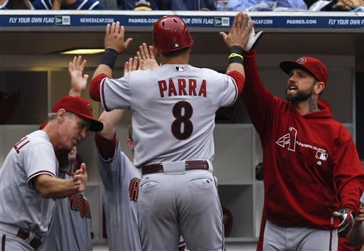 Arizona Diamondbacks' Gerardo Parra (8) is greeted at the dugout after scoring the go-ahead run on a balk against the San Diego Padres during the seventh inning of a baseball game on Saturday, June 2, 2012, in San Diego. (AP Photo/Lenny Ignelzi)