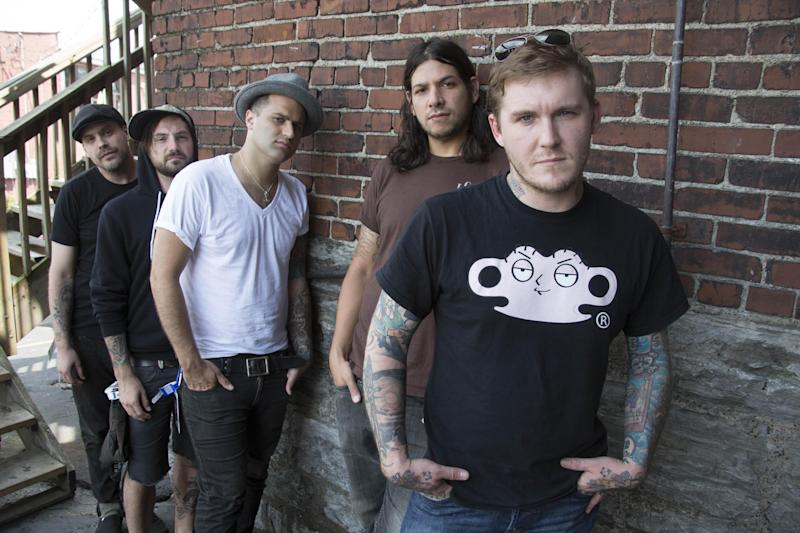 "FILE - In this July 18, 2012 file photo, from right, Brian Fallon, Benny Horowitz, Alex Levine, Alex Rosamilia, and Ian Perkins, of the musical group, The Gaslight Anthem, pose for a portrait at the Cannery Ballroom, in Nashville, Tenn. The Gaslight Anthem was back in Nashville last week for a concert stop and to talk about ""Handwritten,"" the much anticipated new release from a band with a lot of high hopes pinned to it. (Photo by Ed Rode/Invision/AP, File)"