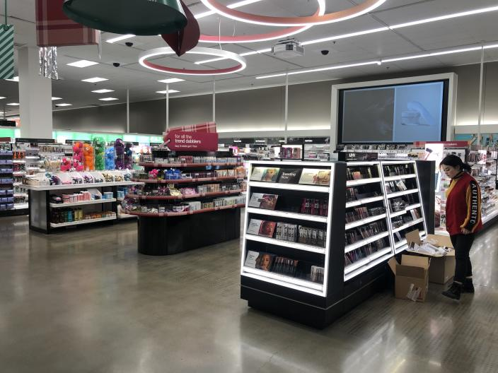 A Target associate restocks a newly remodeled beauty department at a Target store in Minneapolis.