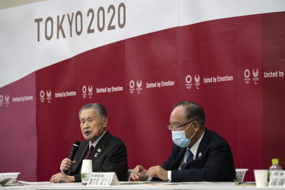 Yoshiro Mori, the president of the Tokyo 2020 Organizing Committee, speaks during the opening remarks session of the Tokyo2020 Olympics Executive Board Meeting, Tuesday, Dec. 22, 2020 in Tokyo, Japan. Honorary President Fujio Mitarai is at right. (Carl Court/Pool Photo via AP)