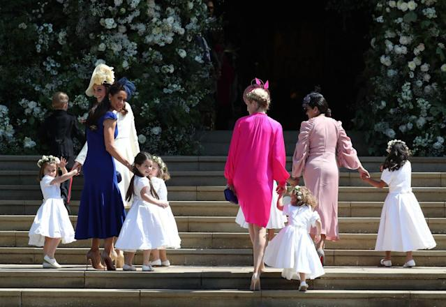 Charlotte is spotted on the far left waving before the ceremony. (Photo: Getty Images)