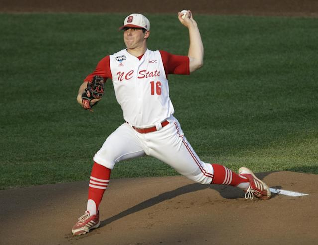 FILE - In this June 20, 2013 file photo, North Carolina State pitcher Carlos Rodon throws against North Carolina during an NCAA College World Series elimination baseball game in Omaha, Neb. The Houston Astros are on the clock to lead off the Major League Baseball draft for the third straight year Thursday night June 5, 2014. Houston has a few options with the first pick, including a pair of California high school stars in left-hander Brady Aiken and catcher-outfielder Alex Jackson, and North Carolina State lefty Carlos Rodon. (AP Photo/Nati Harnik, File)