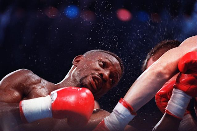 Boxer Pernell Whitaker delivers an uppercut during his bout against Julio Cesar Chavez in San Antonio, Texas. Mandatory Credit: Holly Stein/ALLSPORT