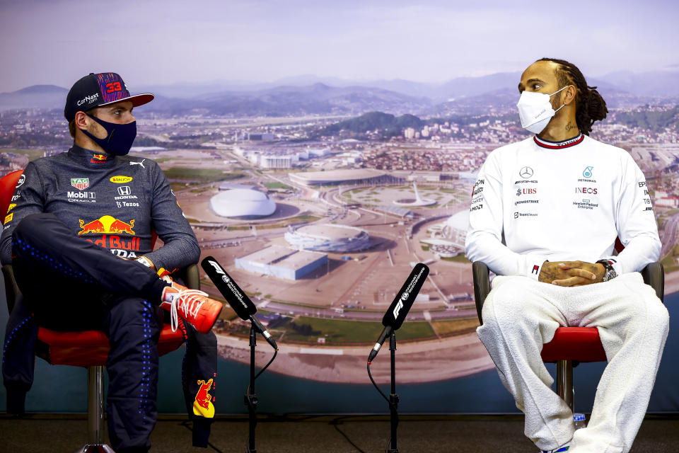 SOCHI, RUSSIA - SEPTEMBER 26: Race winner Lewis Hamilton of Great Britain and Mercedes GP and second placed Max Verstappen of Netherlands and Red Bull Racing talk in the press conference after the F1 Grand Prix of Russia at Sochi Autodrom on September 26, 2021 in Sochi, Russia. (Photo by Andy Hone - Pool/Getty Images)