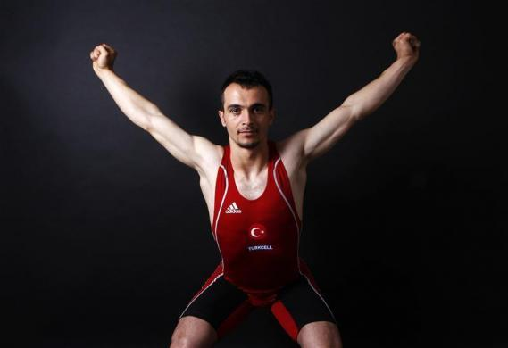 Turkish weightlifter and Olympic hopeful Mete Binay, 27, poses in Ankara May 29, 2012. Binay is a world champion weightlifter and his daily diet is 3500 kcal. He drinks at last two glasses of milk every night. His diet is largely composed of red meat. He consumes plenty of sweet desserts everyday and takes care never to miss a full breakfast. Binay is also keen on organic food. Shortly before competitions he begins to supplement his diet with ergogenic aids and vitamin pills.
