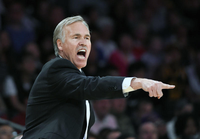 FILE - In this April 13, 2014, file photo, Los Angeles Lakers head coach Mike D'Antoni gestures to his team during the second half of an NBA basketball game against the Memphis Grizzlies in Los Angeles. D'Antoni has resigned after less than two seasons on the job. Lakers spokesman John Black confirmed D'Antoni's resignation Wednesday, April 30. (AP Photo/Mark J. Terrill, File)