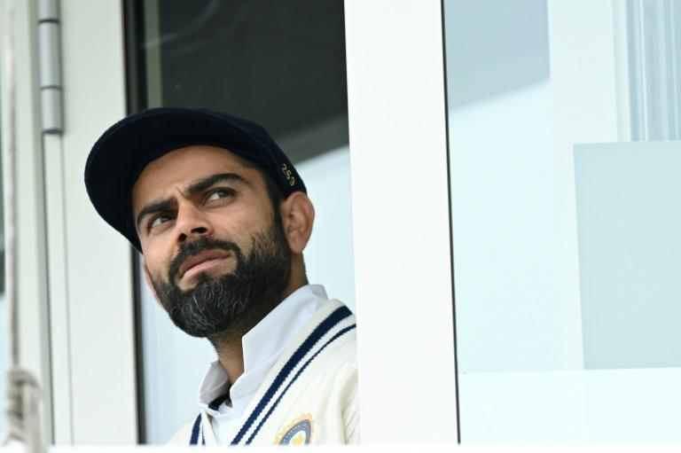 India captain Virat Kohli looks out of the dressing room window prior to the start of Tueday's fifth day in the World Test Championship final against New Zealand at Southampton