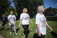 CORRECTS TO FUNERAL HOME VIEWING INSTEAD OF FUNERAL People wear T-shirts with images of Petito as they attend the funeral home viewing of Gabby Petito at Moloney's Funeral Home in Holbrook, N.Y. Sunday, Sept. 26, 2021. (AP Photo/Eduardo Munoz Alvarez)