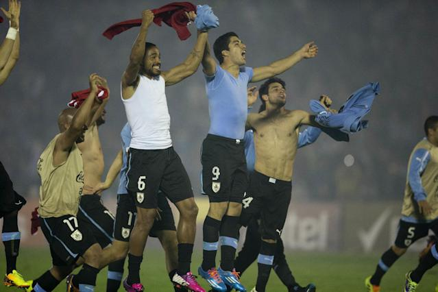 Uruguay's players celebrate after qualifying for the 2014 World Cup after playing a qualifying playoff second leg soccer match with Jordan in Montevideo, Uruguay, Wednesday, Nov. 20, 2013. The match ended 0-0. (AP Photo/Eduardo Di Baia)