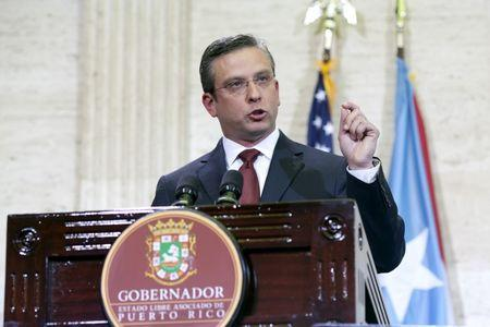 Puerto Rico's Governor Alejandro Garcia Padilla delivers his state of the Commonwealth address at the Capitol building in San Juan