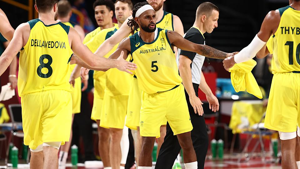 Patty Mills and the Boomers, pictured here celebrating their quarter-final victory over Argentina.