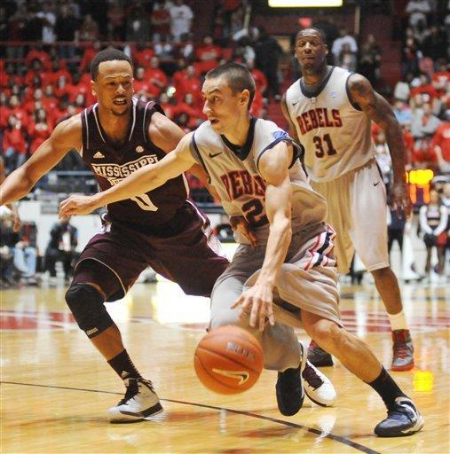Mississippi's Marshall Henderson (22) drives against Mississippi State's Jalen Steele (0) during an NCAA college basketball game Wednesday, Feb. 6, 2013, in Oxford, Miss. Mississippi won 93-75. (AP Photo/Oxford Eagle, Bruce Newman)
