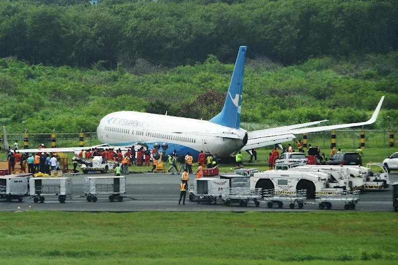 Flight MF8667 from Xiamen to Manila skidded off the runway while attempting to land in bad weather