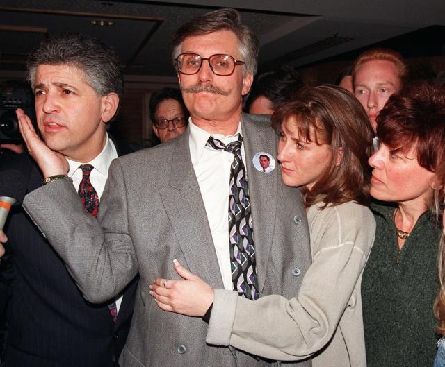 <p>Fred Goldman, center, pats the cheek of his attorney Daniel Petrocelli, left, while being hugged by his daughter Kim and wife Patti following the verdict in the wrongful death civil suit against O.J. Simpson, Tuesday, Feb. 4, 1997 in Santa Monica, Calif. Simpson was found liable for the deaths of Nicole Brown Simpson and Ronald Goldman. (Photo: Michael Caulfield/AP) </p>