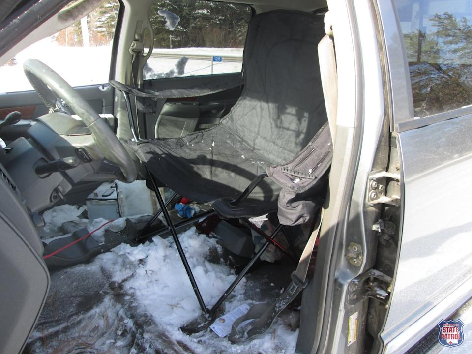 A camper chair pictured in a ute as a substitute for a car seat.