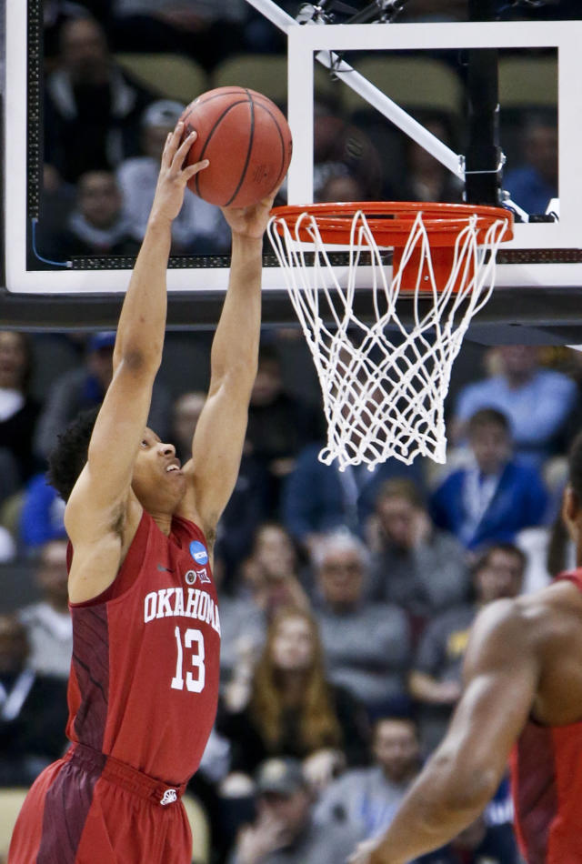 Oklahoma's Jordan Shepherd (13) dunks against Rhode Island during the first half in the first round of the NCAA men's college basketball tournament, Thursday, March 15, 2018, in Pittsburgh. (AP Photo/Keith Srakocic)