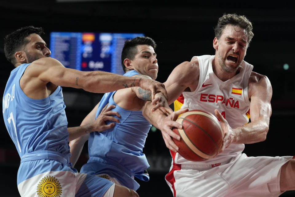 Spain's Pau Gasol, right, fights for a rebound with Argentina's Facundo Campazzo, left, and Gabriel Deck, center, during a men's basketball preliminary round game at the 2020 Summer Olympics, Thursday, July 29, 2021, in Saitama, Japan. (AP Photo/Eric Gay)