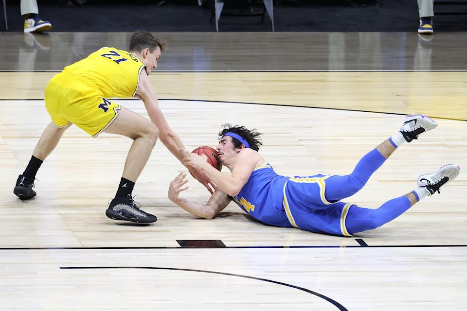Jaime Jaquez Jr. dives for a loose ball against Franz Wagner in the Elite Eight.