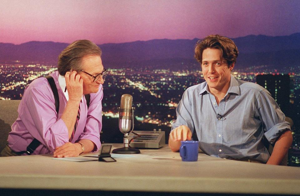 Hugh Grant being interviewed by Larry King during a taping of Larry King Live in Los Angeles Wednesday, July 12, 1995. (Photo: ASSOCIATED PRESS)