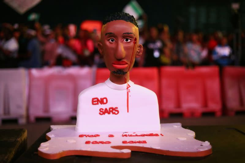 "A cake moulded as a man with an inscription ""End Sars"", referring to the Special Anti-Robbery Squad (SARS), is pictured during a protest over police brutality in Lagos"