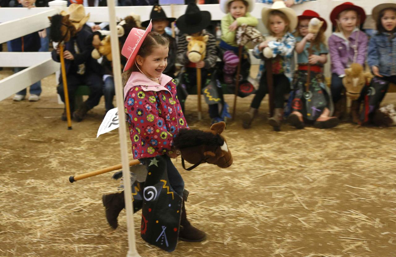 Sophia Pennington competes in the stick horse rodeo competition at the 108th National Western Stock Show in Denver January 11, 2014. The show, which features more than 15,000 head of livestock, opened on Saturday and runs through January 26. REUTERS/Rick Wilking (UNITED STATES - Tags: ANIMALS SOCIETY)