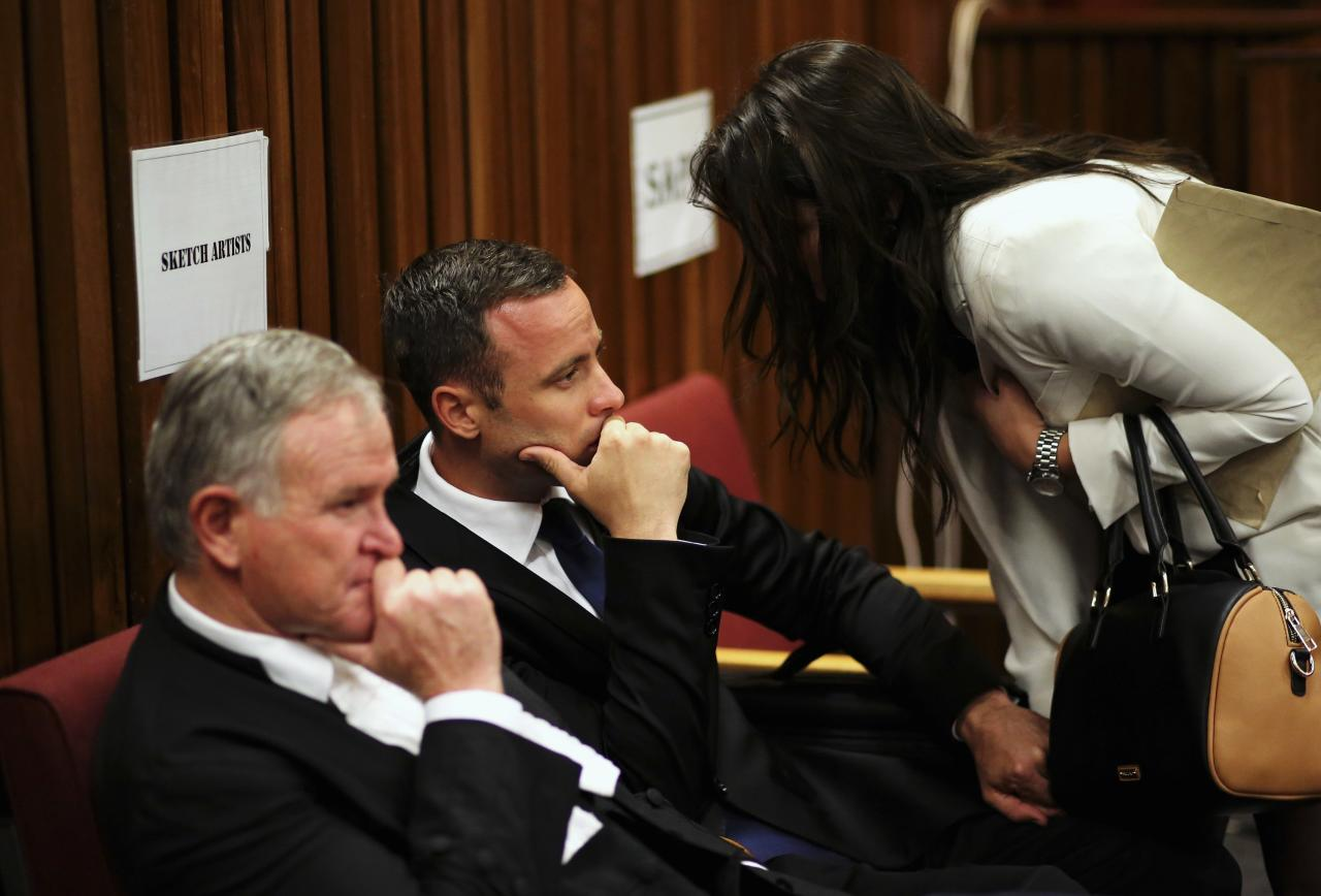 Barry Roux (L) sits with his client Olympic and Paralympic track star Oscar Pistorius at the end of the trial for the murder of his girlfriend Reeva Steenkamp, at the North Gauteng High Court in Pretoria, March 17, 2014. Pistorius is on trial for murdering his girlfriend Reeva Steenkamp at his suburban Pretoria home on Valentine's Day last year. He says he mistook her for an intruder. REUTERS/Siphiwe Sibeko (SOUTH AFRICA - Tags: CRIME LAW SPORT ATHLETICS)