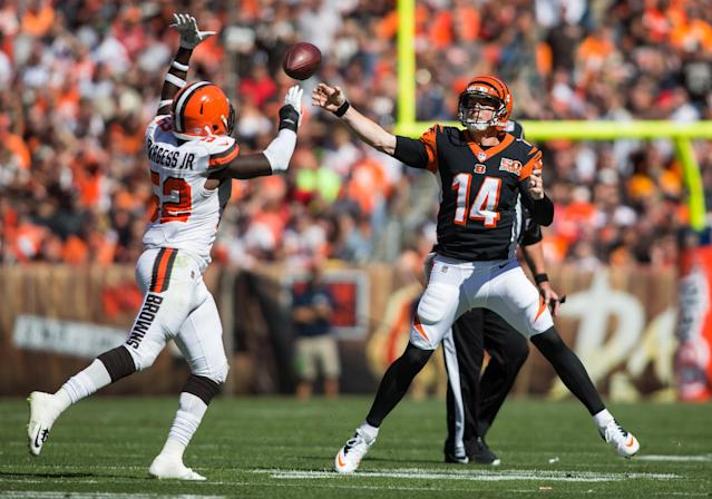 <p>Cincinnati Bengals quarterback Andy Dalton (14) completes a pass under pressure from Cleveland Browns inside linebacker James Burgess (52) during the first quarter at FirstEnergy Stadium. Mandatory Credit: Scott R. Galvin-USA TODAY Sports </p>