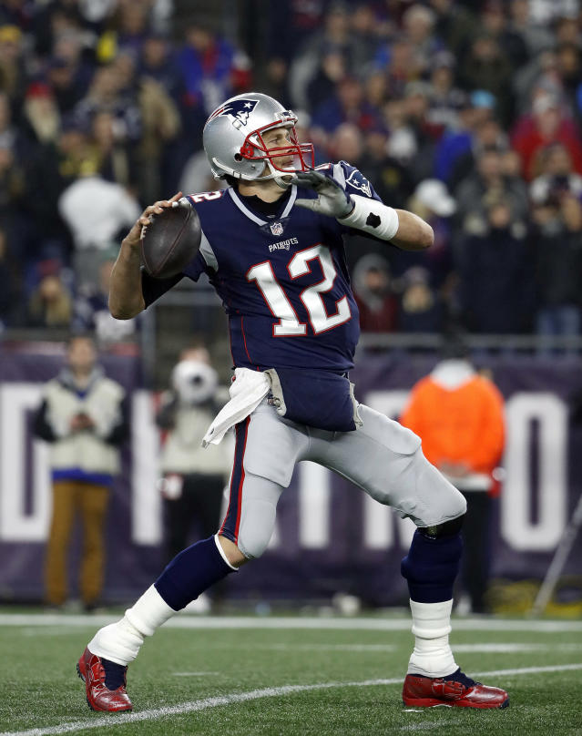 FILE - In this Dec. 2, 2018, file photo, New England Patriots quarterback Tom Brady throws during an NFL football game against the Minnesota Vikings at Gillette Stadium, in Foxborough, Mass. For nine straight years New Englands final few weeks of the regular season have included the celebration of an AFC East title and typically an accompanying first-round bye in the playoffs. The Patriots can lock up a 10th consecutive division title this week with a win or tie against Buffalo. But they are very much in a fight to avoid playing in the wild-card round for the first time since 2009. (AP Photo/Winslow Townson, File)