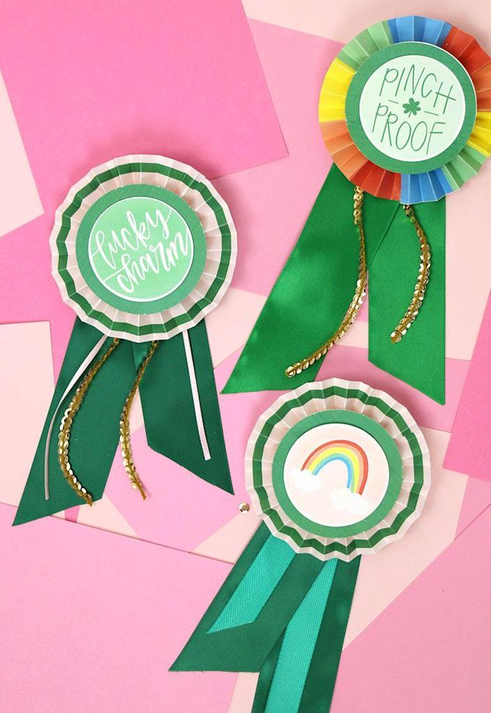 """<p>You can make these super-cute St. Patrick's Day award ribbons in no time at all. Just print and cut the free printables and then craft the ribbon!</p><p><strong>Get the tutorial at <a href=""""https://persialou.com/st-patricks-day-diy-paper-award-ribbons/"""" rel=""""nofollow noopener"""" target=""""_blank"""" data-ylk=""""slk:Persia Lou"""" class=""""link rapid-noclick-resp"""">Persia Lou</a>.</strong></p><p><a class=""""link rapid-noclick-resp"""" href=""""https://www.amazon.com/Mudder-Pieces-Silver-Clasp-Brooch/dp/B01M7Q0NWK/?tag=syn-yahoo-20&ascsubtag=%5Bartid%7C2164.g.35012898%5Bsrc%7Cyahoo-us"""" rel=""""nofollow noopener"""" target=""""_blank"""" data-ylk=""""slk:SHOP PIN BACKS"""">SHOP PIN BACKS</a><br></p>"""