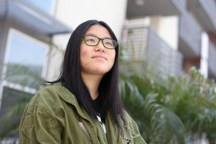 LOS ANGELES, CA - MARCH 30: Mina Lee, a junior at John Marshall High school who has decided to finish the school year remotely, stands for a portrait outside her home in Koreatown on Tuesday, March 30, 2021 in Los Angeles, CA. She is not a fan of the Zoom-in-school hybrid set-up. (Dania Maxwell / Los Angeles Times)