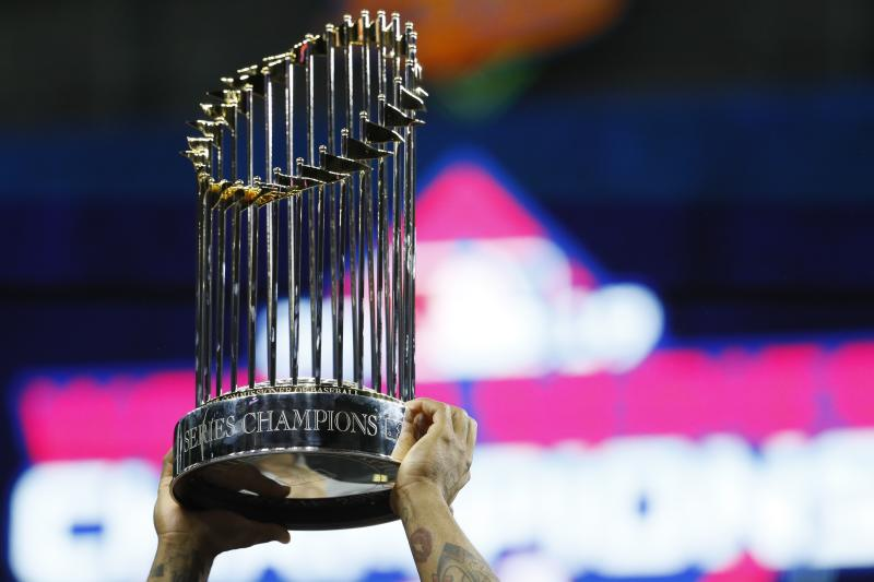 The championship trophy is held up after Game 7 of the baseball World Series between the Houston Astros and the Washington Nationals Wednesday, Oct. 30, 2019, in Houston. The Nationals won 6-2 to win the series. (AP Photo/Matt Slocum)