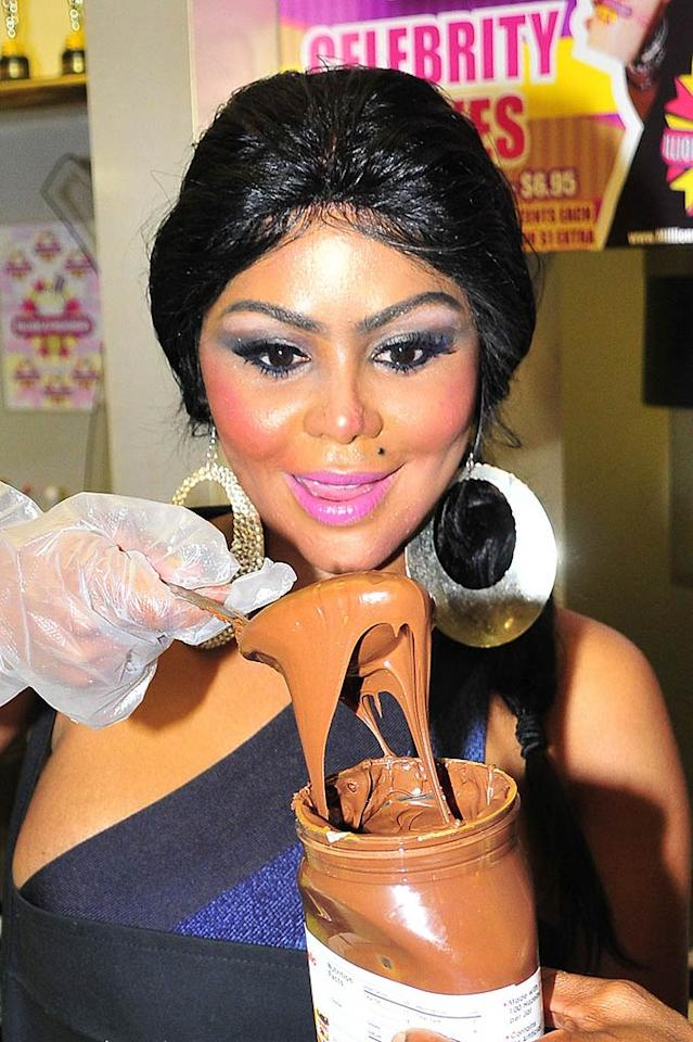 "Lil' Kim was spotted celebrating her 36th birthday -- and wearing a truckload of makeup -- at Millions of Milkshakes in West Hollywood, where she recently unveiled her signature sipper. Based on this photo, what do you think the Queen Bee's concoction should be called? Koi Sojer/<a href=""http://www. PacificCoastNews.com"" target=""new"">PacificCoastNews.com</a> - July 11, 2010"