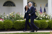 FILE - In this May 13, 2021, file photo President Joe Biden walks with Vice President Kamala Harris after speaking on updated guidance on face mask mandates and COVID-19 response, in the Rose Garden of the White House in Washington. Thanks to growing availability of the coronavirus vaccine and a recent relaxation of federal guidance on masks and distancing, the Biden administration is embracing the look and feel of pre-pandemic days on Pennsylvania Avenue. (AP Photo/Evan Vucci, File)