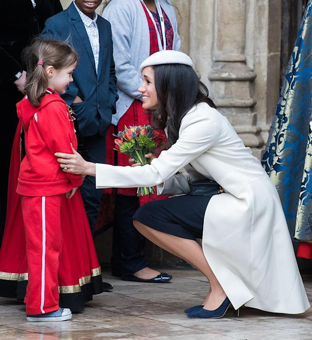 <p>Prince Harry's bethrothed made a little girl's day on Monday, when she accepted a bouquet of flowers from her at the 2018 Commonwealth Day service at Westminster Abbey in London. (Photo: Samir Hussein/Samir Hussein/WireImage) </p>