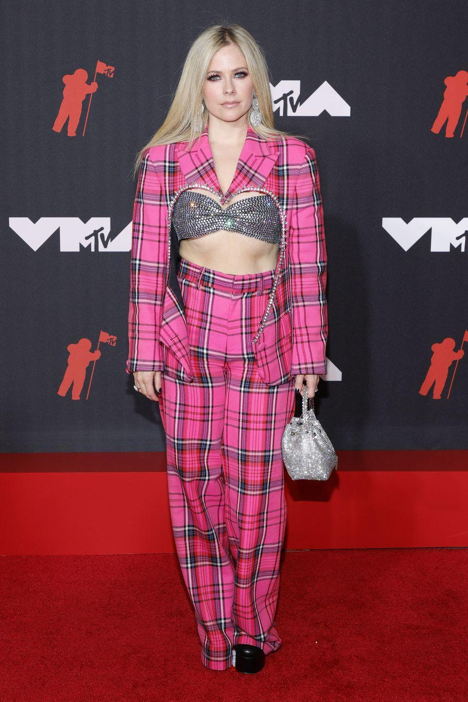 <p><strong>12 September</strong></p><p>Avril Lavigne chanelled Clueless in a checked Area suit. </p>