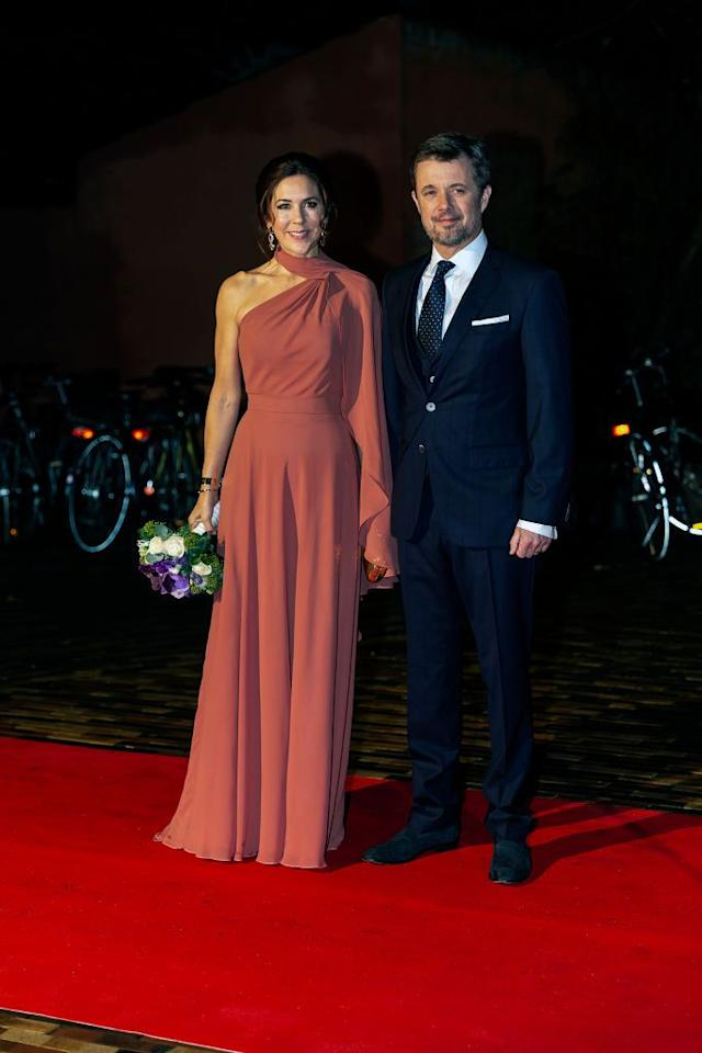<p>Crown Princess Mary donned a one-shoulder, dusty rose gown for the Crown Prince Couples Prize Awards. She paired her formal dress with dangly earrings and a floral bouquet. </p>