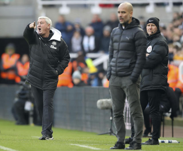 Manchester City manager Pep Guardiola, right, and Newcastle United manager Steve Bruce during the English Premier League soccer match between Newcastle United and Manchester City at St James' Park, Newcastle, England, Saturday, Nov. 30, 2019. (Owen Humphreys/PA via AP)