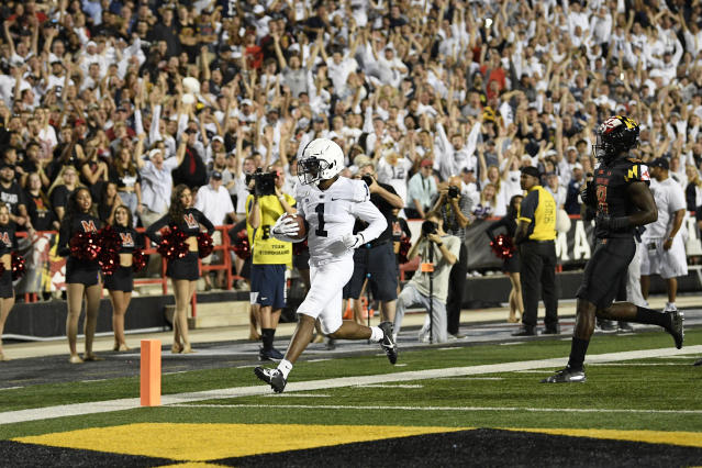 Penn State wide receiver KJ Hamler (1) scores a touchdown past Maryland defensive back Jordan Mosley (18) during the first half of an NCAA college football game, Friday, Sept. 27, 2019, in College Park, Md. (AP Photo/Nick Wass)