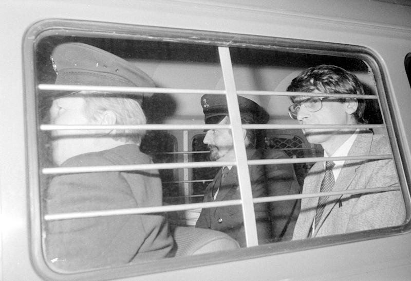BLACK AND WHITE ONLY File photo dated 04/11/83 of mass murderer Dennis Nilsen (right), with a prison warden at his side, after he was sentenced to a minimum of 25 years imprisonment after being convicted of six murders and two attempted murders at the Old Bailey. Serial killer Dennis Nilsen has died in prison, the Ministry of Justice has said.