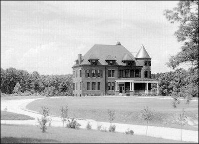 The red brick house was built as the official residence for the superintendent of the Naval Observatory. This photo is from about 1895, before the Observatory roads were paved. (Photo: U.S. Naval Observatory Library)