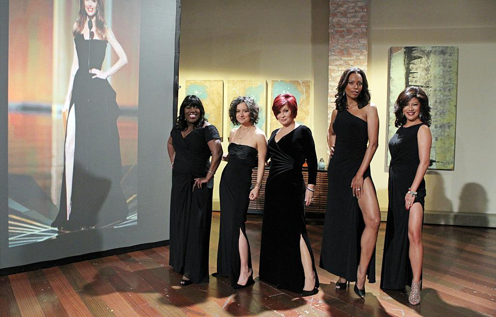 "Jumping on the mocking-Angelina-Jolie-for-her-ridiculous-leg-bearing-pose-at-the-Oscars bandwagon, the ladies of CBS' ""The Talk"" donned black gowns and did their best impression of the actress on their show on Monday. (2/27/2012)"