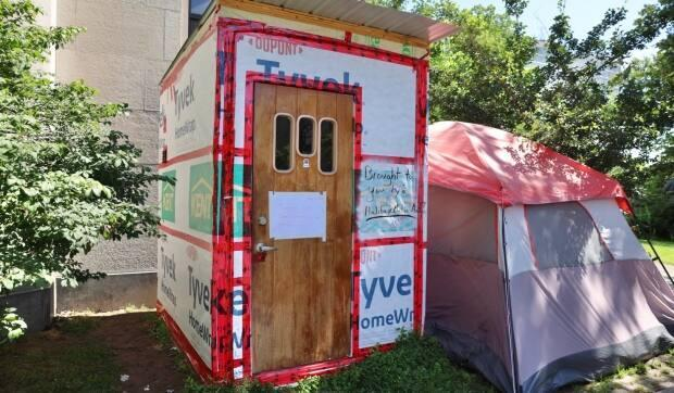 The city of Halifax has begun removing temporary shelters on municipal property ahead of a July 13 deadline. This shelter outside the old Halifax library on Spring Garden Road is one of two still standing and occupied on Saturday. (Jeorge Sadi/CBC - image credit)