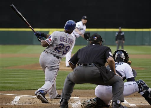 Texas Rangers' Adrian Beltre flies out in the first inning of a baseball game against the Seattle Mariners baseball game, Saturday, Sept. 22, 2012, in Seattle. Beltre re-joined the team after being away Friday with a medical issue. (AP Photo/Ted S. Warren)