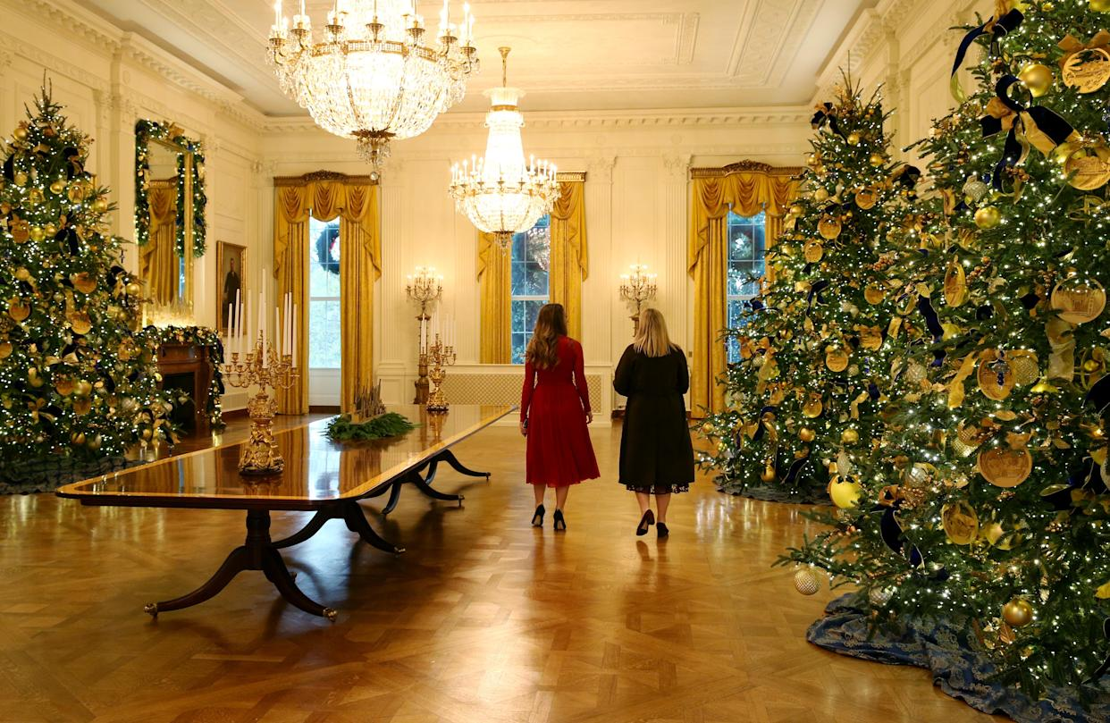 Staff members walk through the decorated East Room during the 2018 Christmas Press Preview at the White House in Washington, D.C., Nov. 26, 2018. (Photo: Leah Millis/Reuters)