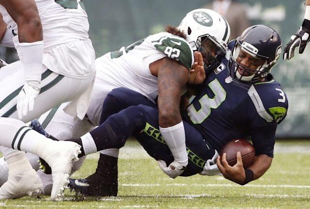 Russell Wilson is dealing with knee, ankle and pectoral injuries (AP)