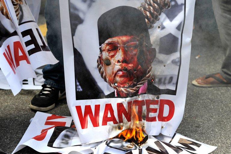 Malaysian demonstrators burn a poster of self-proclaimed Philippine Sultan Jamalul Kiram III during a protest outside the Philippine embassy in Kuala Lumpur, on March 7, 2013, against the followers of the sultan who landed on Malaysia's Borneo island on February 12 to assert a long-dormant territorial claim. Kiram has reportedly fled Malaysia, although his family insist he is still in the country