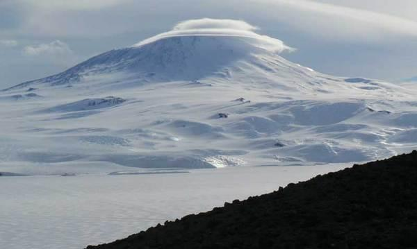Majestic Erebus, topped with a swirl of clouds.